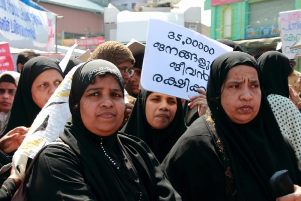 A group of Muslim women rallying with placard in Kerala. Image by Aji Jayachandran. Copyright Demotix (8/12/2011)