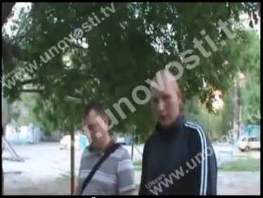One of Tornovoi's murderers (on right) describes to the police how exactly he committed the crime. YouTube screenshot, May 17, 2013.