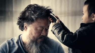 "Prominent Chinese Artist Activist Ai Weiwei has released a music video, Dumbass, which shows his solitary detention back in april 2011 when the Chinese police arrested him for ""tax evasion""."