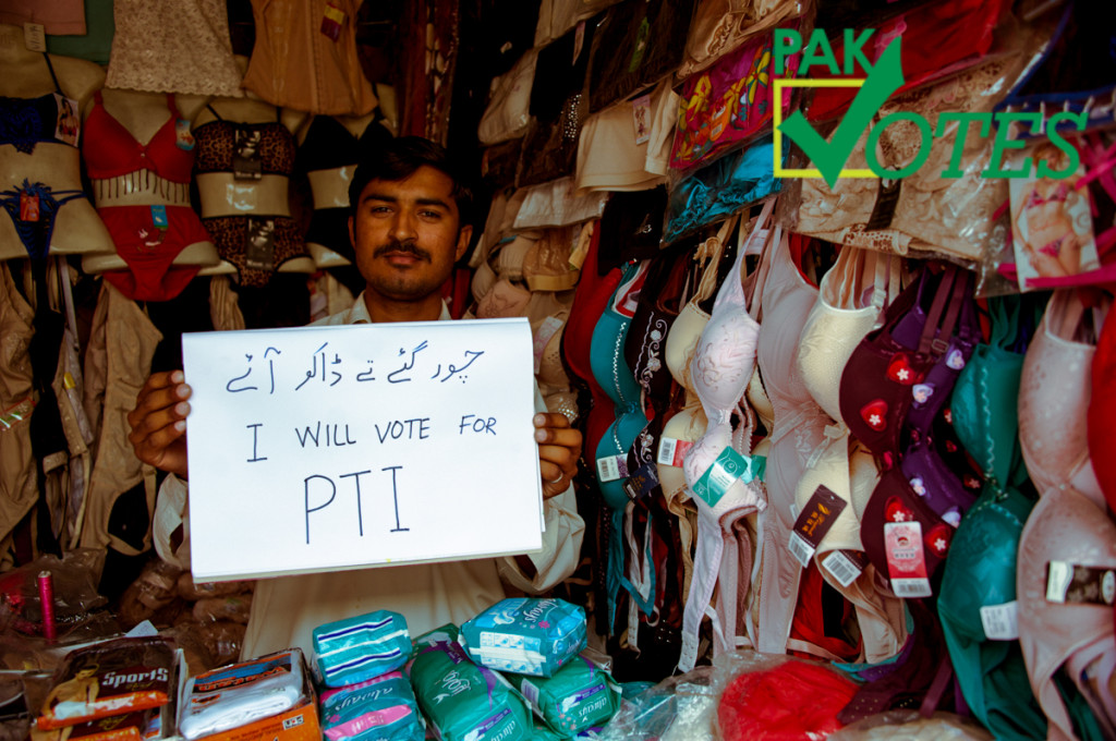 A shopkeeper vows to vote for PTI. Image by @SoofiSays for PakVotes. Used with Permission.