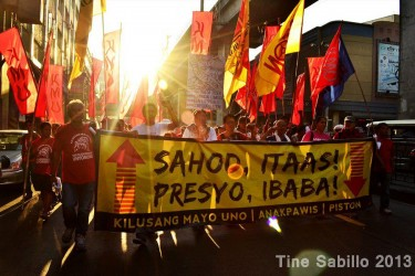Filipino workers march near the presidential palace demanding higher wages and rollback of prices. Photo from Facebook of Tine Sabillo