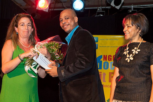 NGC Bocas Lit Fest Founder, Marina Salandy-Brown, looks on as author Monique Roffey is presented with the 2013 OCM Bocas Prize; photo by Maria Nunes, used with permission