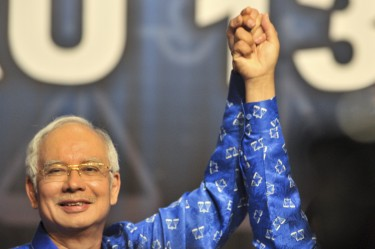 Malaysia's Prime Minister Najib Razak celebrates after winning the elections. Photo by Hilmi Jaafar, Copyright @Demotix (5/6/2013)