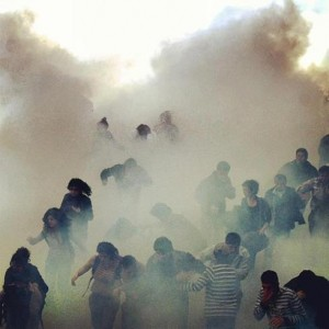 Istanbul demostrators under teargas on Labor Day celebrations