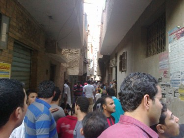 People gather at the alley in which the house where the Shia were killed in Cairo today. Photograph shared on Twitter by @7azem122