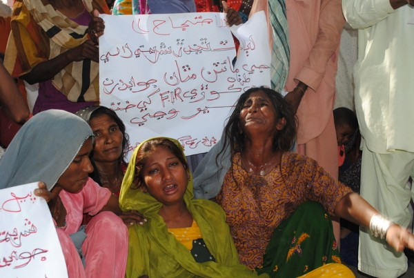 Victims of rape along with relatives, hold a protest against their alleged culprits to demand their arrest. They also want to bring to light alleged rape by police officers caused by none payment of bribes. Hyderabad, Pakistan. Image by Rajput Yasir. Copyright Demotix. 14th November 2011.