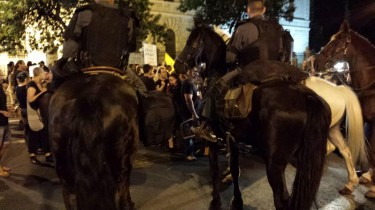 Policemen riding horses surround #j14 protesters near the Prime Minister's residence in Jerusalem Photo: #j14 activist Gali Fialkow