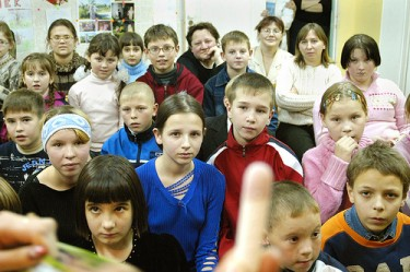 """Explaining Dipping Sticks to Russian Orphans"" Kaluga, Russia. Photo by Robert Dann CC 2.0"