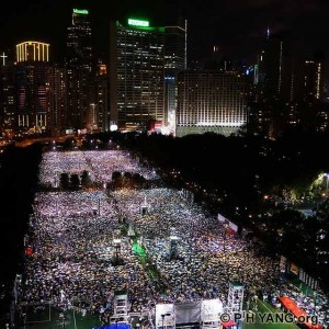 150,000 people brave thunderstorms and torrential rain for the 24th June 4 Candlelight Vigil at Victoria Park in Hong Kong. Photo by PH Yang.