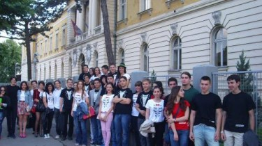 The graduating class of Pirot High School in front of their school on the day of their graduation.
