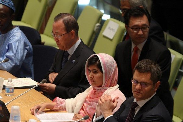 Malala Yousafzai, the Pakistan teen who survived an assassination attempt by the Taliban, at the United Nations on Friday. Beside her at left, is Ban Ki-moon, UN Secretary-General, and Mr. Vuk Jeremiae, President of the General Assembly. Image by Nancy Siesel. Copyright Demotix. (12 July 2013)