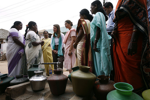 Melinda Gates speaks with women serving on the Bangalore Water Supply and Sewerage Board.  Image from Flickr by Gates Foundation. BY-NC-ND (Bangalore, India, 2005)