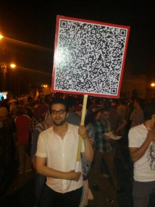 An innovative protest sign. Leave written in 14 languages coded in QR. Photograph shared on Twitter by @AssemMemon