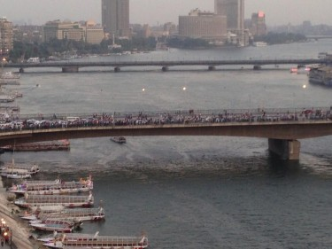 Thousands of pro-Morsi protestors cross the October 6 bridge. Photograph shared by @AymanM on Twitter