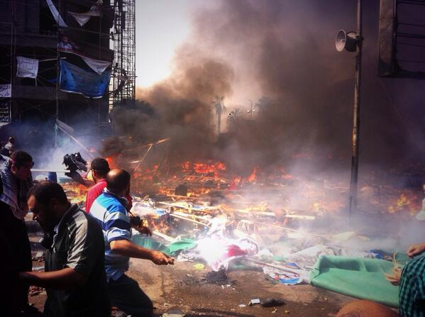 """""""Scene at Rabaa's frontline resembles a warzone."""" Photo by Egyptian photojournalist Mosa'ab Elshamy,from his Twitter account @mosaaberizing"""