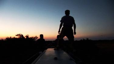 Migrants on cargo train