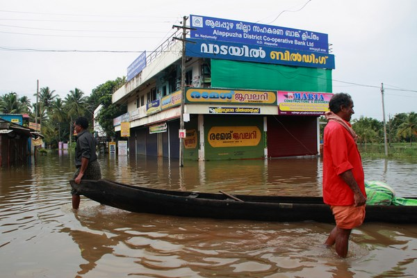 Kuttanad, India. 26th June 2013 -- A boat as pictured here is floating on the road submerged in flood water.
