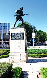 The Askari Monument in Dar Es Salaam, Tanzania. Photo released into the Public Domain by Wikipedia user Moongateclimber.