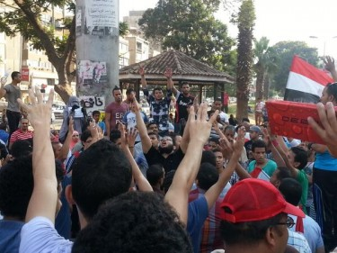 Pro-Morsi supporters on the Arab League street in Cairo. Photograph shared by @evanchill on Twitter