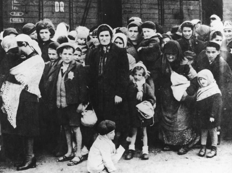 A group of Jewish men, women and children being led to a concentration camp during WW II; photo provided by by the German Federal Archives, used under Creative Commons 3.0 license.