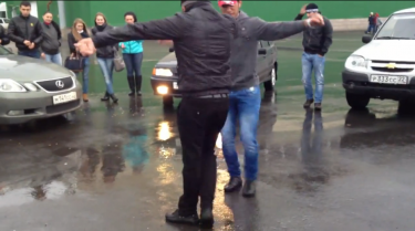 Two men dancing the lezginka on a Barnaul street. YouTube screenshot.