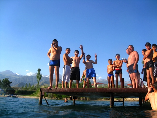 Tourists jump off a rickety pier. Photo by Kate Sampsell-Willmann.
