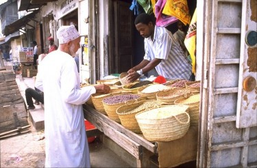A market stall in Stone Town, Zanzibar, which is one of the most popular sites for tourists. Photo released under Creative Commons (CC BY-SA 3.0) by Wikipedia user Esculapio.