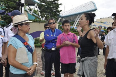 Ho Loy, a guest speaker for the Empty the Tanks protest argued with one of the organizer about the decision to remove the blood-tainted dolphin and some of the protesters.