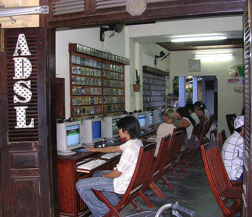 An internet cafe in Vietnam. Image from Flickr page of mikecogh (CC License)