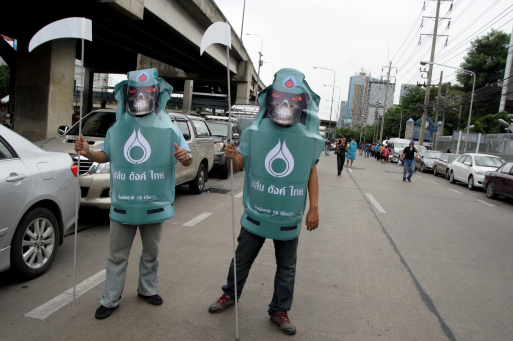 Protesters wearing LPG Gas dress during a rally. Photo by Piti A Sahakorn, Copyright @Demotix (9/23/2013)