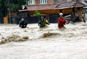 Rescuers and locals push through the floodwater in Eastern Romania; photo courtesy of Balkan Inside, used under Creative Commons license.