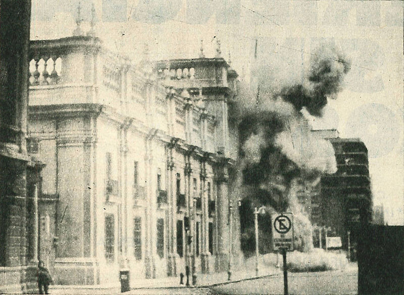 Bombing of La Moneda, September 11, 1973. Image from Wikimedia Commons under Creative Commons license CC BY 3.0 CL