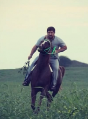 Ramzan Kadyrov shows off his horse riding skills, 29 August 2013, screen capture from YouTube.
