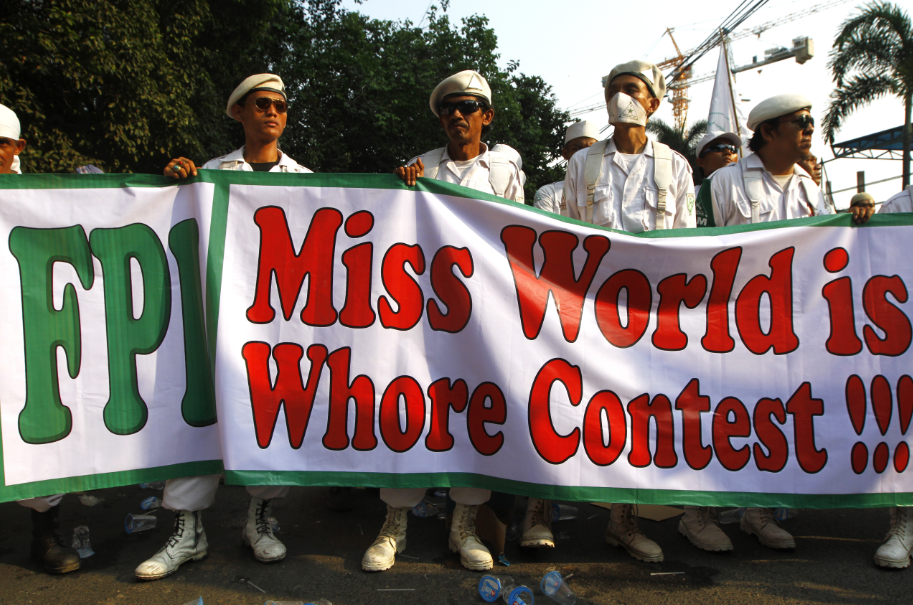 Muslim demonstrators hold posters rejecting the Miss World 2013 in Jakarta. Photo by dharma wijayanto, Copyright@Demotix (9/3/2013)