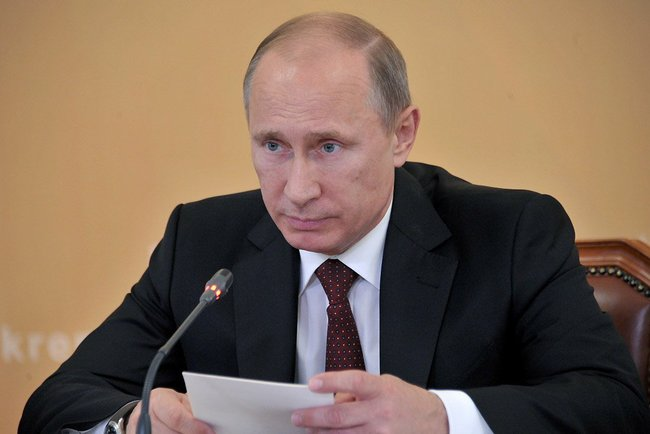 Vladimir Putin, 16 July 2013, Kremlin press service, public domain.