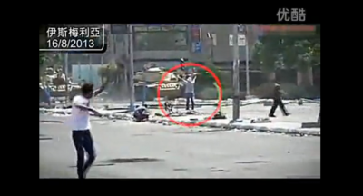 Screen capture of the Youku video on state violence in Egypt. An unarmed man is trying to block a military tank.