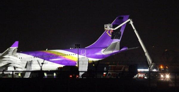 Covering the Thai Airways logo with a black paint. Image from @RichardBarrow