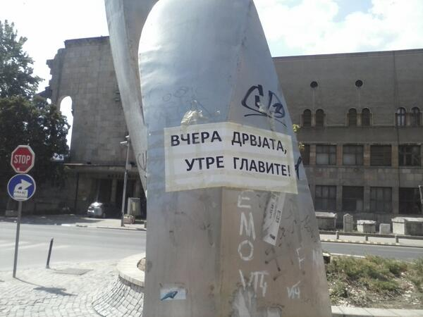 "A sign in downtown Skopje says: ""Yesterday trees, tomorrow heads""; photo by  , used with permission."