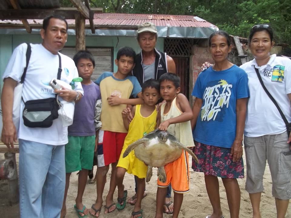 Residents of Turtle Island shortly before releasing the sea turtle. Photo by Ma Cecilia Mendioro Gendrano