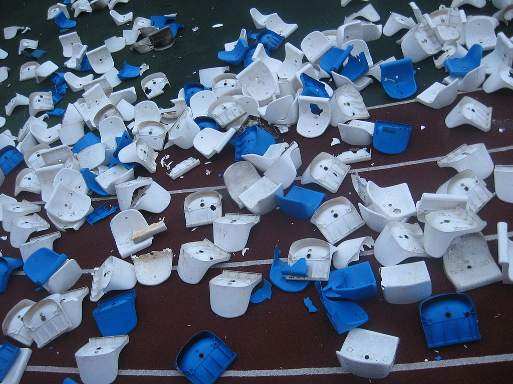 Broken plastic chairs in stadium, after a football game. Bryansk, Russia, 2008. Source: Wikimedia, Creative Commons 3.0 license.