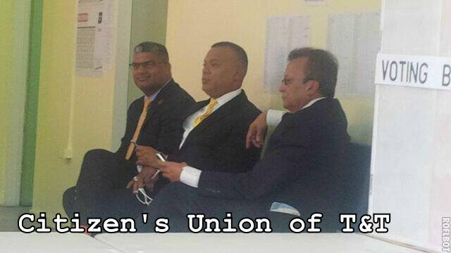 Ian Alleyne flanked by Attorney General Anand Ramlogan (l) and Ganga Singh (r)
