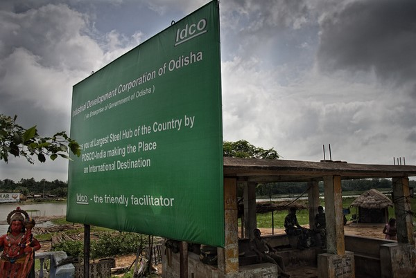 A signboard outside the village of Bailatutha. The bus stand behind it now serves as a make shift Police camping spot, keeping an eye on the movements of people in, out and around the proposed area. Image by Ayush Ranka. Copyright Demotix (22/7/2011)