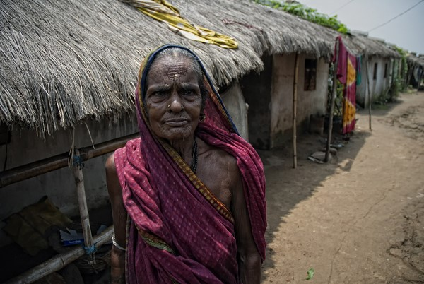 An old woman inside the transit camp of POSCO-India. They have suffered for the last four years in overcrowded, unhygienic living conditions with only Rs.20 (50 cents) per person per day to live on. Image by AYush Ranka. Copyright Demotix (22/6/2011)