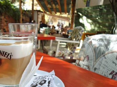 Enjoying a latte macchiato at the Shipja e Vjetër café in Prishtina