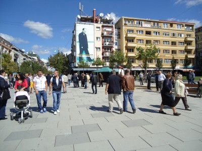 In the center of Prishtina, Rugova is still there, but the colors are washed out.