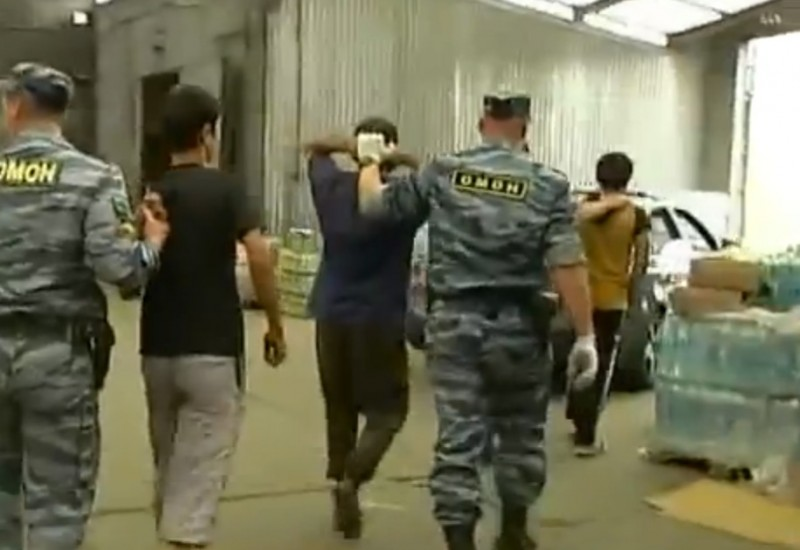 Migrants detained at a raid on a Moscow market. Authorities have been cracking down in what some see as an appeal to Russian nationalism. YouTube screenshot.