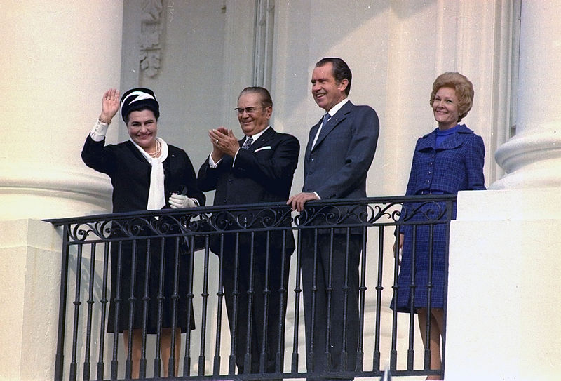 President Josip Broz Tito and Mrs. Broz, President Richard Nixon and Mrs. Nixon overlooking arrival ceremony on the South Lawn from the South Balcony of the White House; photo form the  White House Photo Office Collection, public domain.