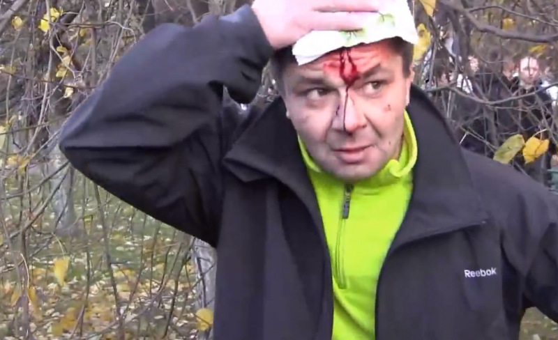 Demonstrator injured in Biryulevo, 13 October 2013, screenshot from YouTube video.
