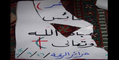 Suad Nofal´s banner, in solidarity with the Christian population, torn by ISIS. Source: Suad Nofal´s facebook page