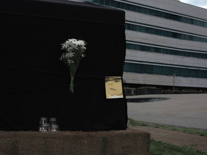 "The day after baby Belmina's death, activists placed a black sheeth with Belmina's picture over a new monument in front of the Parliament building in Sarajevo; image courtesy of #JMBG za sve (""#JMBG for All""), used with permission."